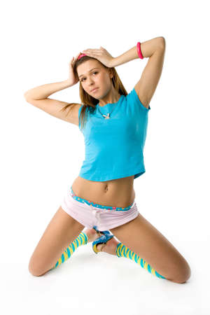 Lovely brunette posing in bright funny clothes photo