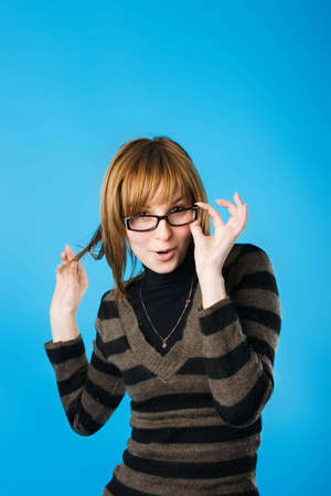 Girl in glasses playing the fool. Find more similar images of this girl in my portfolio.