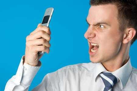 Angry businessman screaming on the mobile phone. Find more similar pictures in my portfolio Stock Photo - 1216441