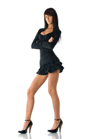 Young smart brunette in little black dress. Isolated over white photo