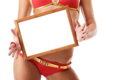 Sexy woman holding wooden frame in front of her