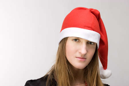 Young girl in santa's cap with beautiful sad eyes Stock Photo - 2240905