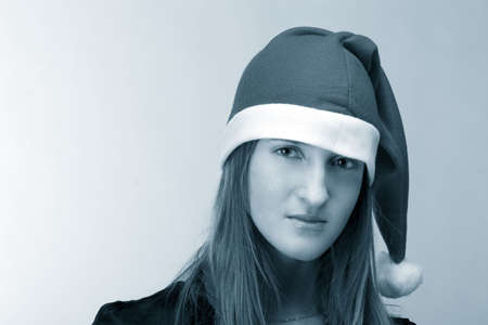 Yuong girl in santa's cap with beautiful sad eyes Stock Photo - 2240901