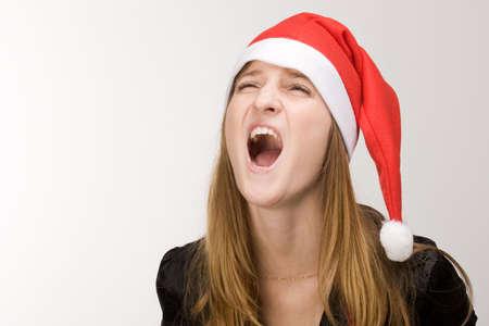Screaming girl in red santa's hat Stock Photo - 2240833