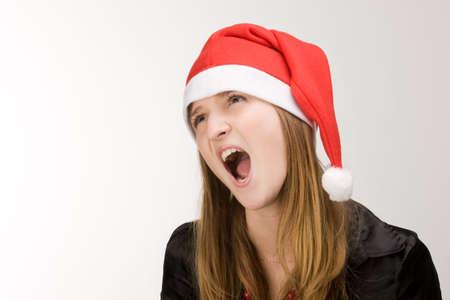Screaming girl in red santa's hat Stock Photo - 2240830