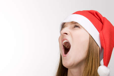 Screaming girl in red santa's hat Stock Photo - 2240868