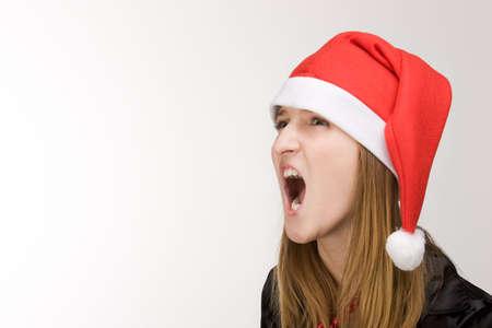 Screaming girl in red santa's hat Stock Photo - 2240861