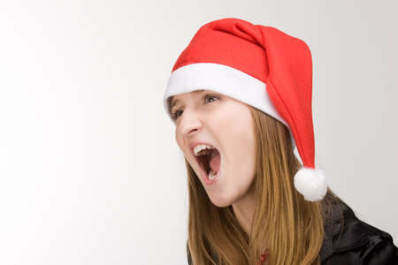 Screaming girl in red santa's hat Stock Photo - 2240862