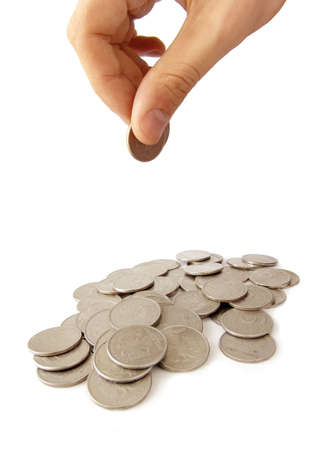 Not very big heap of coins and hand holding coins under it photo