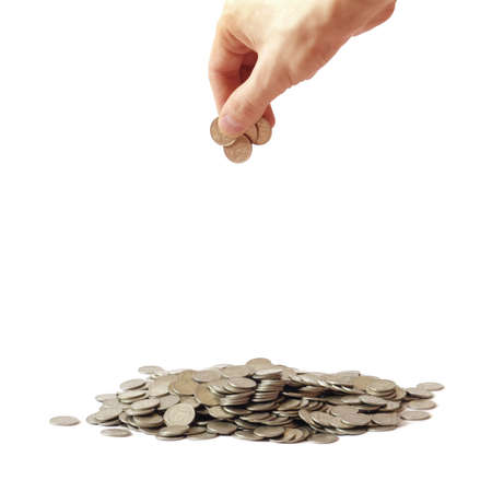 Big heap of coins and hand holding coins under it                  photo