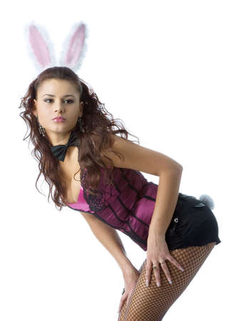 Sexy bunny girl. Isolated over white photo