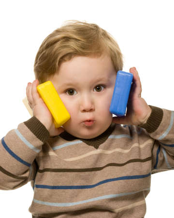 Little boy using toys like a phones  photo
