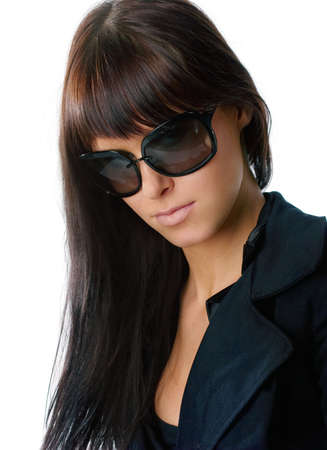Young and fashionable girl posing in sun glasses. Isolated over white photo