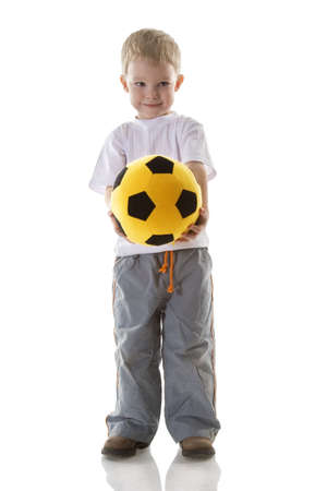 Little boy with yellow  football photo
