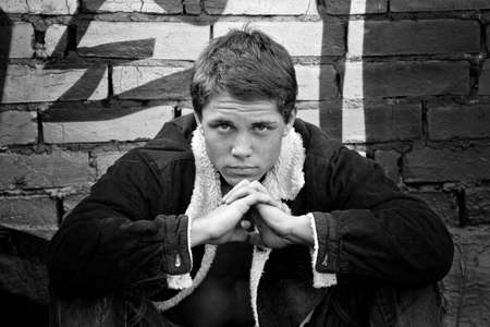 Young serious guy. Monochrome image photo