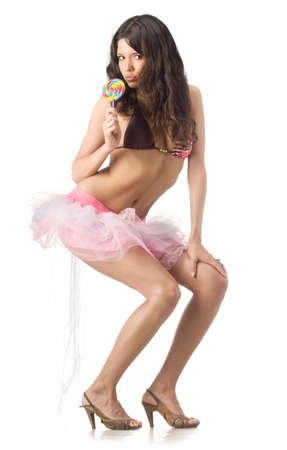 Beautiful girl posing with lollipop. Isolated over white. photo