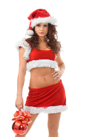 Sexy handsome santa with red ball in hands photo