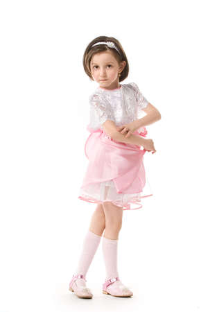 The lovely little girl posing in a beautiful pink dress. Isolated over white background Stock Photo - 3534834