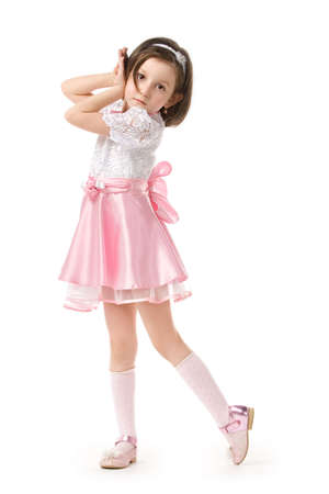 girl socks: 美しいピンクのドレスでポーズ美しい少女白い背景の上の分離 写真素材