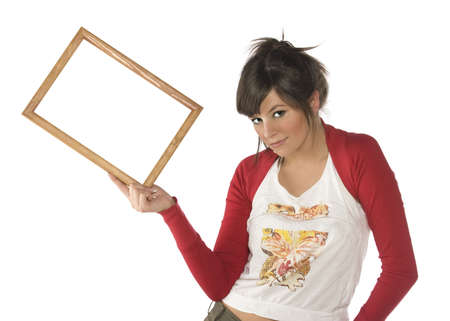 Pretty young woman holding empty frame. Ready for your text or picture. photo
