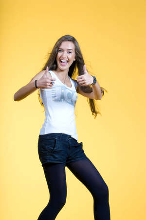 Young happy woman with thumbs up photo