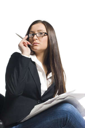 Stylish businesswoman in glasses with pen and papers photo