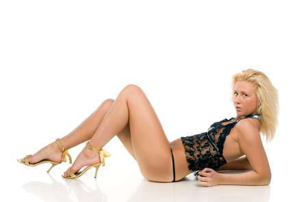 Young blonde woman in sexy black lingerie. Isolated over white.
