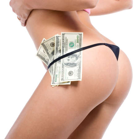 Beautiful womens buttocs in sexy black panties with dollars Stock Photo