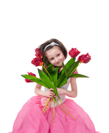 Little girl in pink dress with bouquet of red tulips. Isolated over white photo