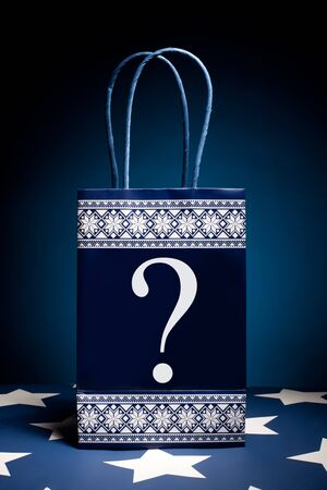Gift bag with question symbol on it. Concept - thinking about holiday gifts. Stock Photo - 8385195