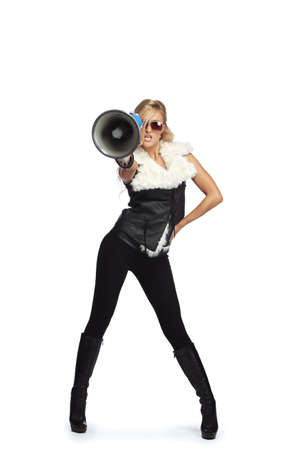 Young fashionable woman shouting in a megaphone Stock Photo - 9332800