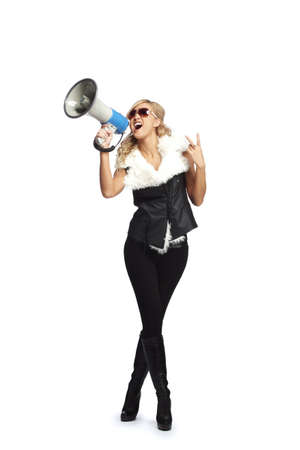 Young fashionable woman with megaphone photo