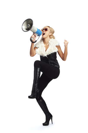 Young blonde woman  shouting through  megaphone photo