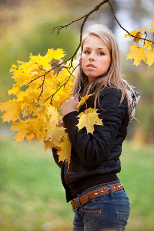beautiful blonde girl with green eyes: Young blondie woman in autumn park Stock Photo