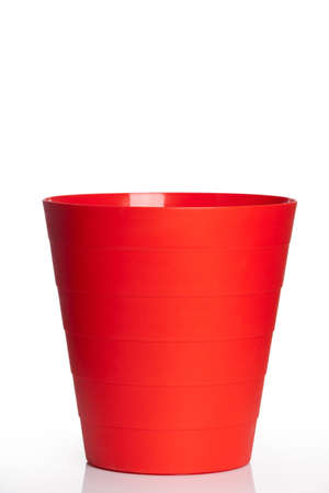 trash can: Big red plastic basket isolated on white background