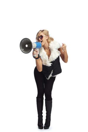 Young blonde woman  shouting through  megaphone Stock Photo - 11099431