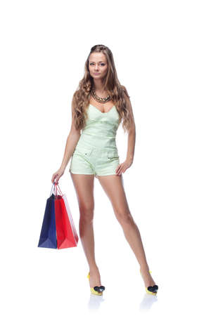 Young blonde woman with shopping bags photo