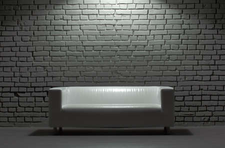 white modern leather sofa and brick background photo