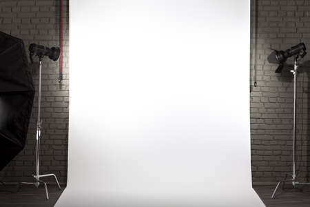 Photo of an empty white background in photographic studio with modern lighting equipment. Empty space for your text or objects photo