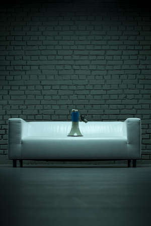 Megaphone on a sofa. Conceptual image - break the silence photo