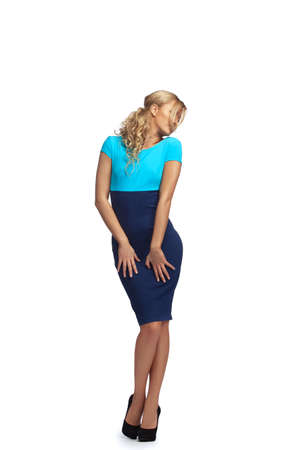 Young blonde woman  posing in stylish blue dress Stock Photo - 11407946