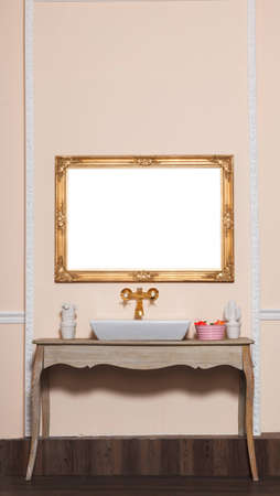 Luxury washstand and golden empty frame photo