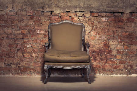 Antique chair against a grungy brick wall Stock Photo - 11407971