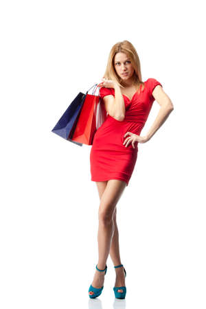 Young stylish blonde woman with shopping bags. Isolated over white background photo