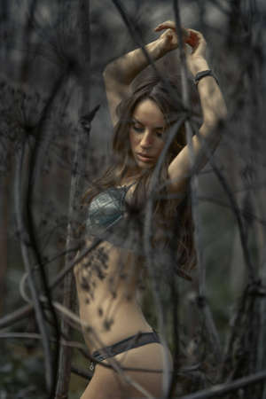 nude outdoors: Young sexy woman posing in thickets Stock Photo