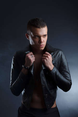 Young stylish man in leather coat photo