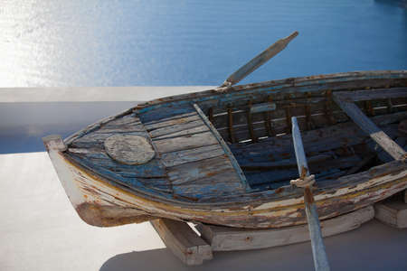 Old fishing boat on the roof in Fira, Santorini island, Greere photo