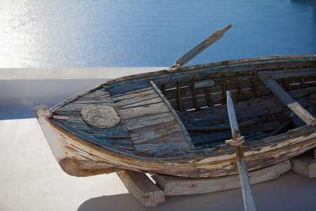 fira: Old fishing boat on the roof in Fira, Santorini island, Greere