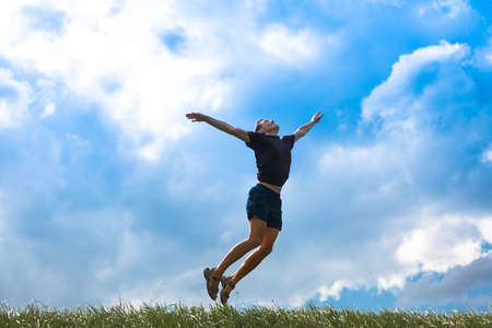 levitation: Young man jumping high in to the sky