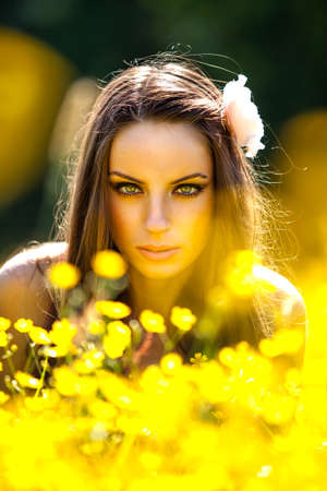 Beautiful woman portrait on summer meadow photo